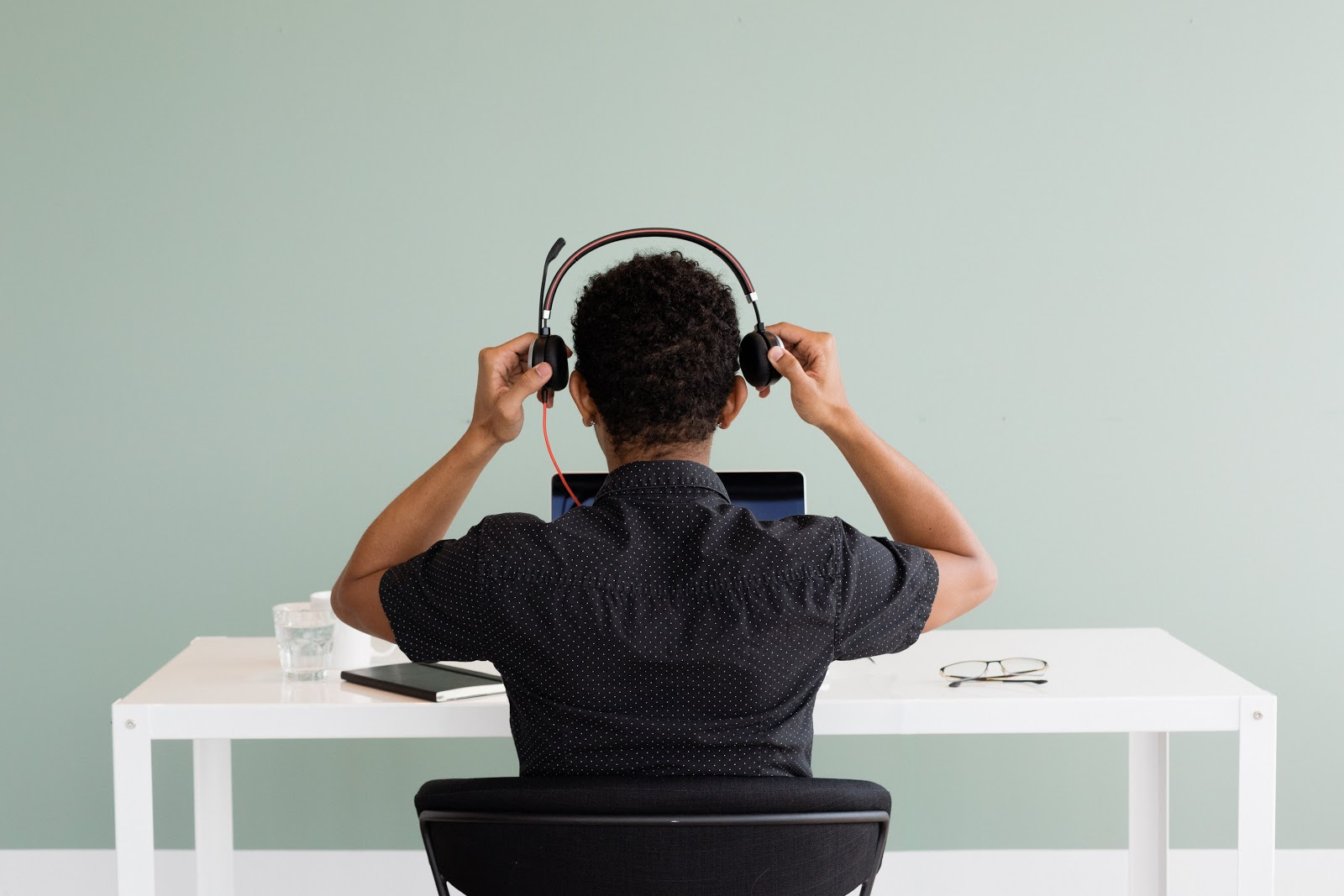 Remote call centre employee putting on headset